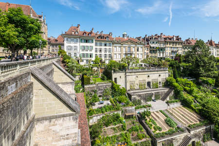 Bern, Switzerland - May 26, 2016: Upscale residential area with terraced gardens near the Bern Cathedral and Aare River. People on the Minster Terrace.