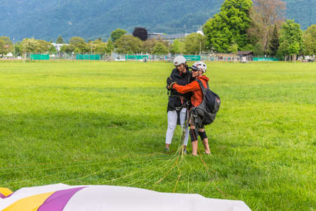 Interlaken, Switzerland - May 26, 2016: Tandem paraglider after landing in Interlaken, Switzerland.