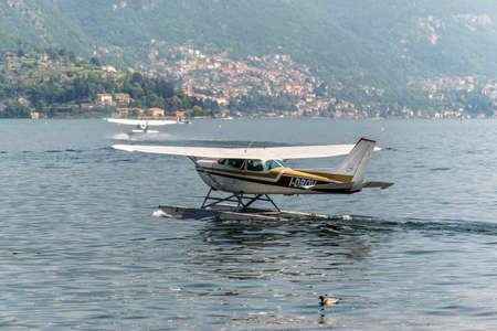 Como, Italy - May 27, 2016: A seaplane Cessna R172K Hawk XP II of the Aero Club Como taxiing on Como lake in Como City, Italy. Editorial