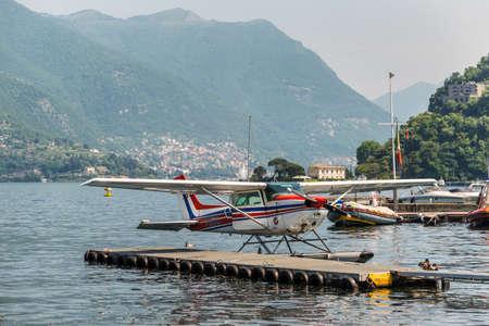Como, Italy - May 27, 2016: A seaplane Cessna 172N Skyhawk 100 II docking on at water aerodrome of Como lake in Como City, Italy.