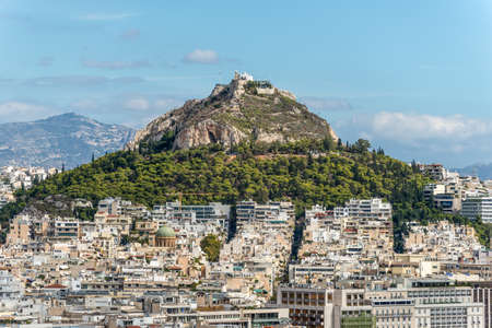 Athens, Greece - November 1, 2017: Cityscape of Athens and Lycabettus Hill, also known as Lykabettos, Lycabettos or Lykavittos. It is a Cretaceous limestone hill in Athens, Greece. 報道画像