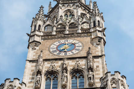 Munich, Germany - May 29, 2016: Clock tower of New Town Hall in famous place Marienplatz square in European city Munich, Germany, Europe.
