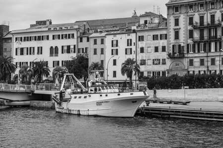 Savona, Italy - December 2, 2016: The Fishing Vessel Padre Pio I in harbor at the Ligurian sea port in Savona, Italy. Black and white photography.