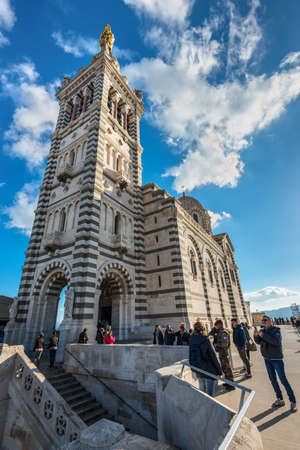 Marseille, France - December 4, 2016: Tourists at the foot of the of Notre Dame de la Garde in Marseille, Provence, France. Editorial