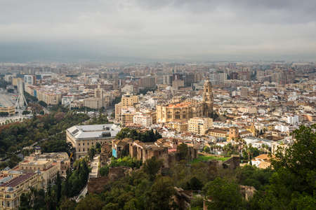 Malaga, Spain - December 7, 2016: Cityscape aerial view and the Cathedral of Malaga before the rain in Malaga, Andalusia, Spain.