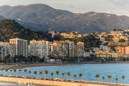 Malaga, Spain - December 7, 2016: Cityscape with the Malagueta Beach in the sunset in Malaga, Andalusia, Spain. Redakční