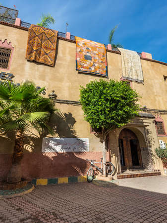 Marrakesh, Morocco - December 8, 2016: Beautiful street and carpets on houses of old medina in Marrakesh, Morocco, Africa.