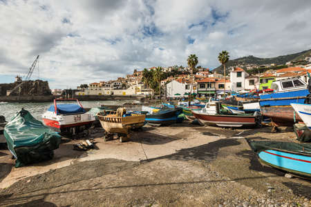 Camara de Lobos, Madeira, Portugal - December 10, 2016: Colorful fishing boats on the shore of fishing village Camara de Lobos near Funchal, Madeira Island, Portugal. Éditoriale
