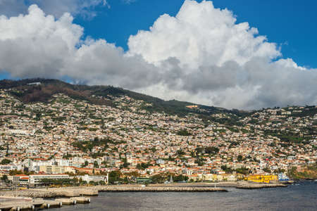 Funchal, Portugal - December 10, 2016: View of the marina and city of Funchal from a ship in the harbour at Seaport of Madeira Island, Portugal. 報道画像