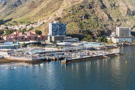Santa Cruz de Tenerife, Canary Islands, Spain - Desember 11, 2016: View along the coast on a sunny day in the harbour of the Santa Cruz de Tenerife, Canary Islands, Spain. Yacht club in the foreground.