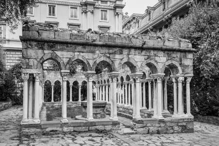 Genoa, Italy - May 14, 2017: View of ruin of a 12th century St. Andrew's cloister standing between Porta Soprana and Christopher Columbus' house in Genoa, italy. B&W photo. Editoriali