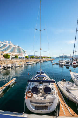 Vigo, Spain - May 20, 2017: Sailing yacht moored in the port of Vigo, Galicia, Spain. Vigo, which was first settled as a small fishing village, is ideally positioned and provides a safe, sheltered harbor.