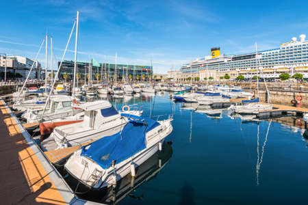 Vigo, Spain - May 20, 2017: Boats moored in the port of Vigo, Galicia, Spain. Cruise ship in the background.
