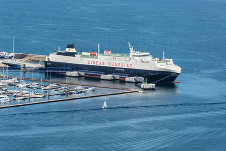 Vigo, Spain - May 20, 2017: Car carrier vessel Suar Vigo moored in the port of Vigo, Galicia, Spain. Vigo, which was first settled as a small fishing village, is ideally positioned and provides a safe, sheltered harbor. Editorial