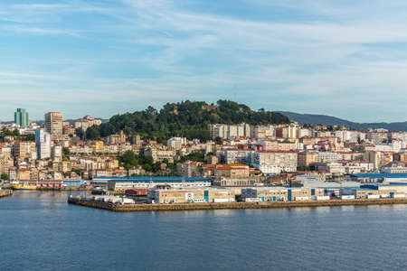 Vigo, Spain - May 20, 2017: Cityscape of the Vigo in Galicia, Spain. Company of seafood and sea delicacies in the foreground. Redactioneel