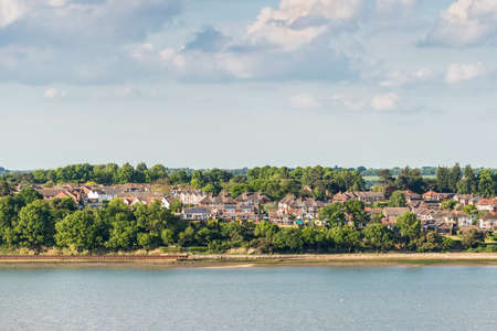 A high viewpoint of the Shotley peninsula coastline taken from cruise ship in Ipswich, England, United Kingdom 写真素材