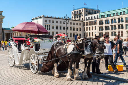 Berlin, Germany - May 27, 2017: Bavaria horses drawn carriage germany style waiting German people and foreigner traveller use service tour around city in Berlin, Germany. 에디토리얼