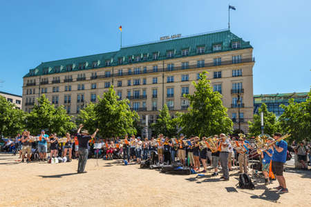 Berlin, Germany - May 27, 2017: Brass band gives a open air concert at weekend in front of the Hotel Adlon Kempinski located in Berlins Mitte, beside the Brandenburg Gate in Berlin, Germany.