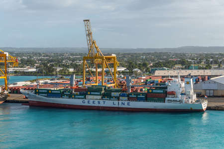 Bridgetown, Barbados - December 18, 2016: Container vessel Benguela Stream moored in port of Bridgetown, Barbados island, Caribbean.