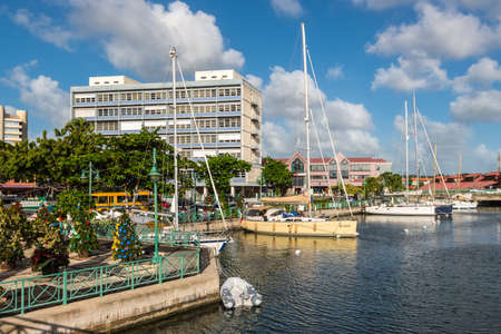 Bridgetown, Barbados - December 18, 2016: Sailing yachts moored in the downtown marina of Bridgetown, Barbados, West Indies, Caribbean, Lesser Antilles. Christmas trees on the left.