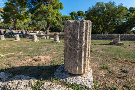 Olympia, Greece - October 31, 2017: The remains of an architectural column in archaeological site of Olympia in Peloponnese Greece. In antiquity the Olympic Games were hosted every four years in Olympia from 776 BC.