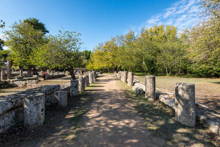Olympia, Greece - October 31, 2017: The remains of an architectural columns in archaeological site of Olympia in Peloponnese Greece. Site of original olympic games.