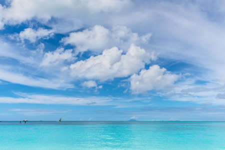 Beautiful marine view on tropical caribbean beach with turquoise water under blue sky and clouds at sunny day as natural background - Valley Church Beach at Antigua and Barbuda island