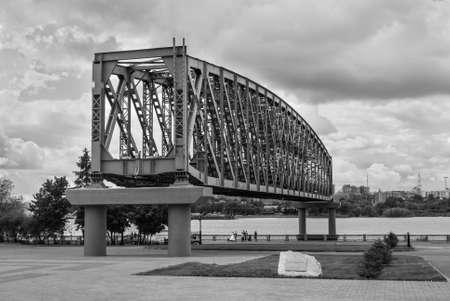 Novosibirsk, Russia - June 28, 2013: The part of railroad bridge on alley Editorial