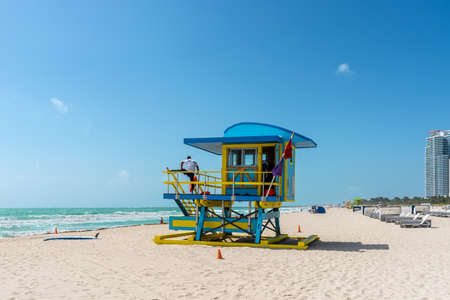 Miami, FL, United States - April 19, 2019: Miami South Beach sunshine with lifeguard tower and coastline with blue sky in Florida, USA. Editorial