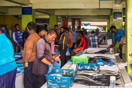 Male, Maldives - November 16, 2017: Lively trade in fresh fish and seafood at the Fish Market in the city and island of Male, capital of Maldives.