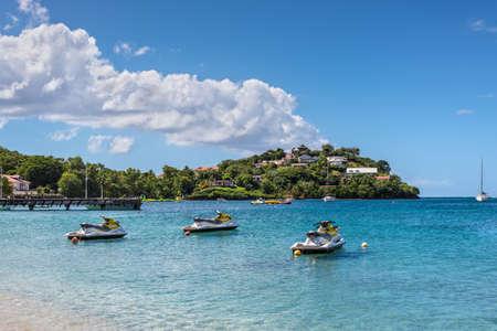 Les Trois-Ilets, Martinique - December 13, 2018: Personal watercrafts (water scooters) at Anse Mitan Beach at Les Trois-Ilets, peninsula La Pointe du Bout, Martinique, FWI. Éditoriale