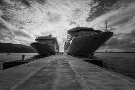 Cruise ships in backlight at quay of port in Tortola, British Virgin Islands. Black and white photography.