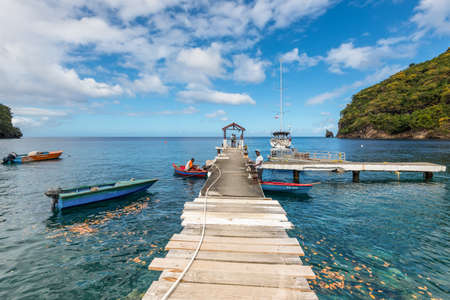 Wallilabou Bay, Saint Vincent and the Grenadines - December 19, 2018: A view from a jetty out to sea at Wallilabou Anchorage - Pirates of the Caribbean's Port Royale - Saint Vincent.