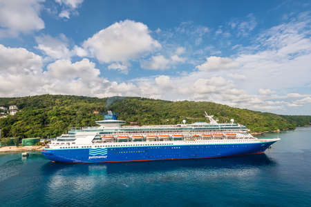 Ocho Rios, Jamaica - April 22, 2019: Cruise Ship Pullmantur Monarch docked in the tropical Caribbean island of Ocho Rios, Jamaica.