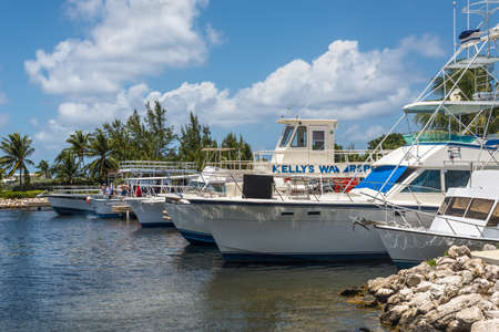 West Bay, Grand Cayman Island, UK - April 23, 2019: Boats moored at harbour near Stingray City in Grand Cayman, Cayman Islands, UK. Stingray city is famous snorkerling spot visited on cruise. Editorial