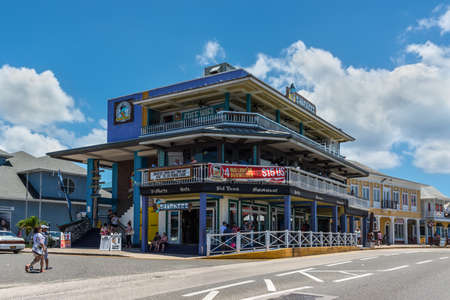 George Town, Grand Cayman Island, UK - April 23, 2019: Street view of George Town at day with pedestrians near tourist shops in downtown of George Town, Grand Cayman, Cayman Islands, British West Indies.