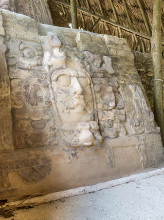 Well preserved statue on the Temple of the Masks at Kohunlich maya archaeological site in pre-Columbian Maya civilization, Yucatan Peninsula, Mexico.