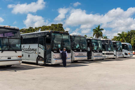 Everglades, United States of America - April 27, 2019: Tourist buses await a group of tourists near the Everglades Holiday Park, Florida, USA.