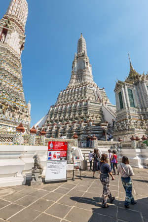 Bangkok, Thailand - December 7, 2019: A tourist people, travelling in the Temple of Dawn or Wat Arun a in Bangkok, Thailand. Urban old town city in holiday vacation. Lifestyle activity concept.