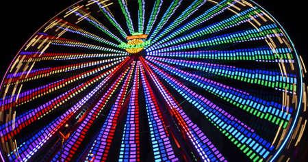 Glowing Neon Carousel in the night sky, amusement park