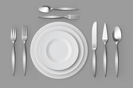 table setting: Cutlery Set of Silver Forks Spoons and Knifes with Plates Top View Isolated on Background. Table Setting