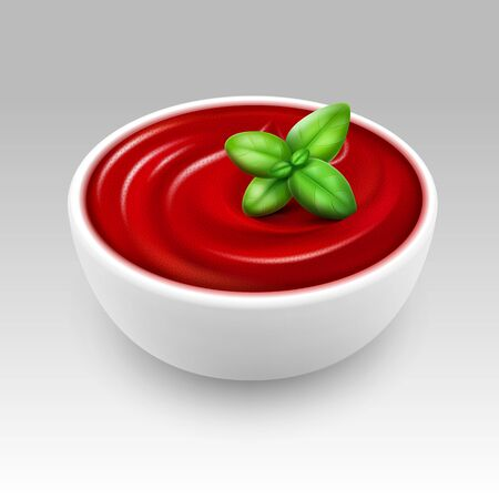 White Bowl of Red Tomato Ketchup Sauce with Green Basil Close up Isolated on White Background