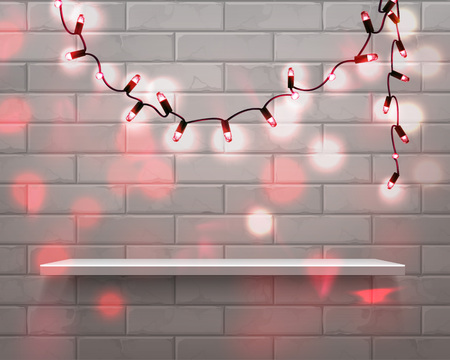 Vector illustration of realistic white shelf in front with Christmas red garland lights on brick wall background with glitter overlay