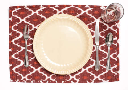 Emply place setting on a red placemat. photo