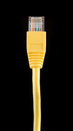 ethernet: A yellow ethernet cable against a black background.