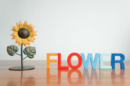 spelled: A flower statue with the word flower spelled with magnets.