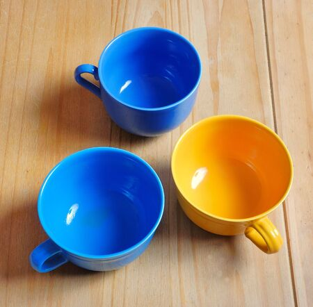 domesticity: Colored bowls on table Stock Photo