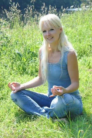 young woman yoga meditation outdoor photo