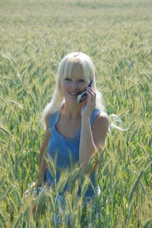 portrait of blond woman phoning   photo