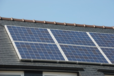House with solar panels on roof   photo